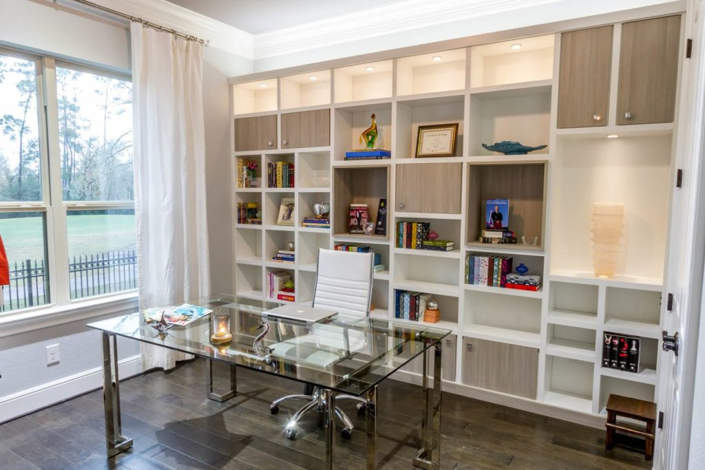 Closet Factory franchise clean organization franchises office space with custom shelving behind the desk